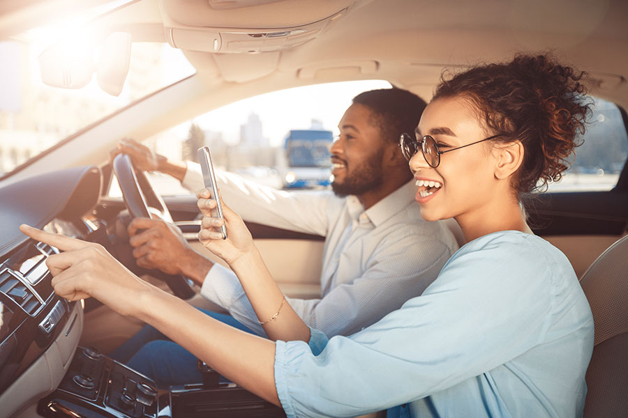Request Auto ID Card - Happy Couple Driving in Car in the City
